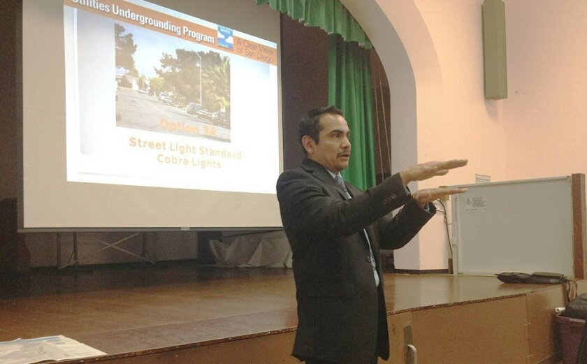 City project manager Mario Reyes tells Muirlands' residents about the process of moving utility lines in their area underground, a 3-4 year job scheduled to begin in mid-2017.