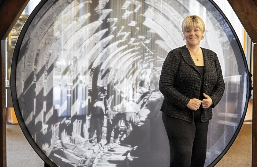 New DWP General Manager Marcie Edwards, in front of an image of the California Aqueduct being built, climbed the ladder at the agency for 24 years early in her career before heading for work in Orange County.