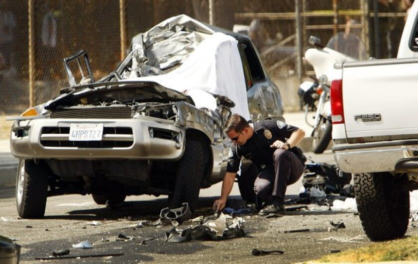 Police investigate a 2012 fatal crash in Woodland Hills, Calif. A report out Tuesday said the number of motor vehicle deaths was up 5% from 2011 to 2012.