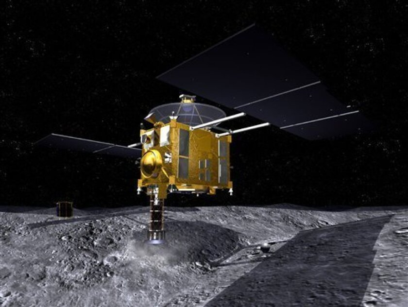 FILE - In this June 1, 2006 artist rendering released by the Japan Aerospace Exploration Agency, or JAXA, and once moved on June 8, 2010, Japanese space probe Hayabusa collects space material on the surface of Asteroid Itokawa, which is floating 290 million kilometers (180 million miles) from the E