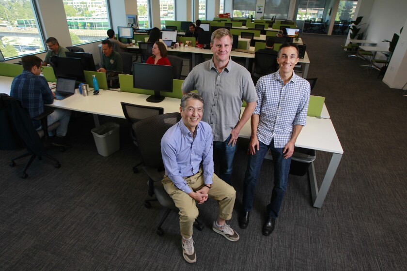 Daasity co-founders (from left) Chris Shimojima, Dan LeBlanc, Sean Corson pose for photo with their employees at the startup's headquarters.