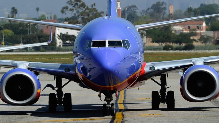 A Southwest Airlines plane taxis on the tarmac after arriving at Los Angeles International Airport. The Dallas-based airline plans to begin selling tickets to flights to Hawaii by the end of the year.