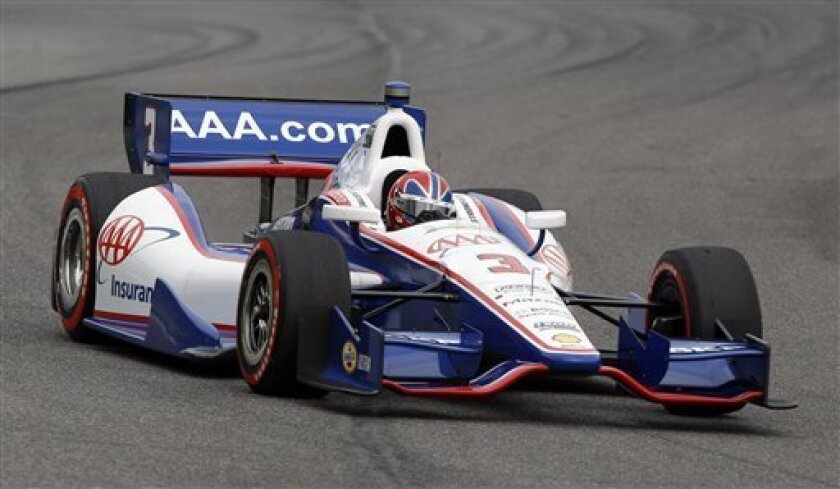 Helio Castroneves, of Brazil, drives during qualifying for the Grand Prix of Alabama IndyCar auto race at Barber Motorsports Park on Saturday, March 31, 2012, in Birmingham, Ala. (AP Photo/Butch Dill)