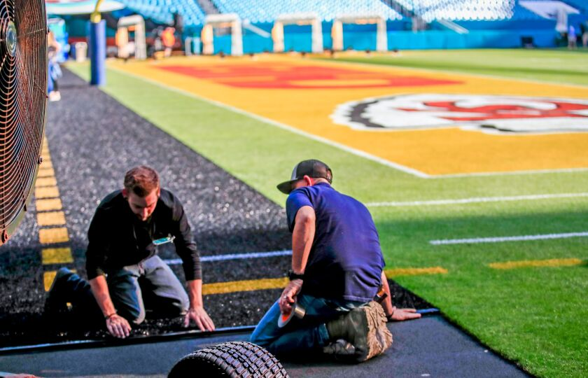 Workers prepare for Super Bowl at Hard Rock Stadium in Miami Gardens, Fla., on Jan. 28.