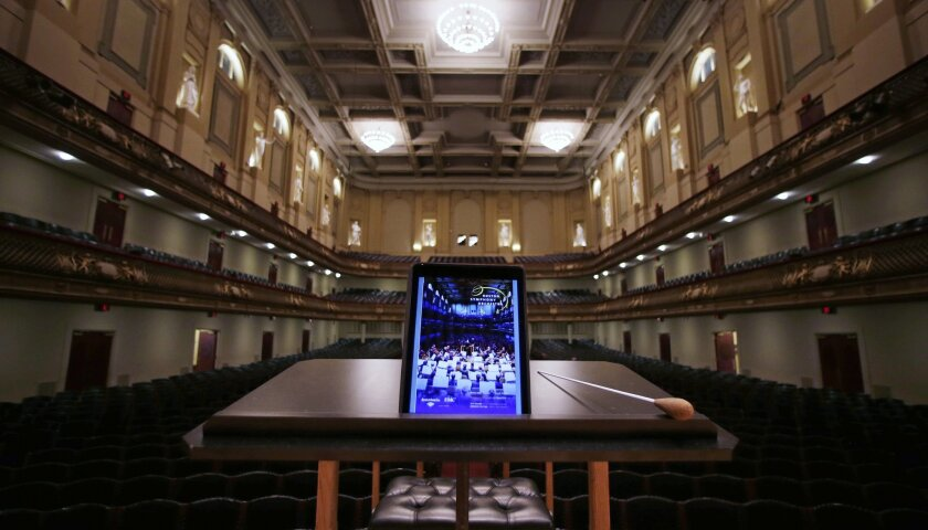 In this Friday, Jan. 15, 2016, photo, an iPad with a Boston Symphony Orchestra interactive program is displayed on the conductor's stand at Symphony Hall in Boston. The BSO is loaning iPads to concertgoers during performances in hopes of drawing new audiences to classical music. (AP Photo/Charles K