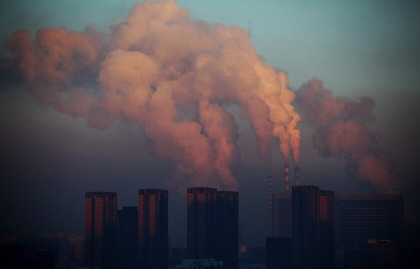 A thermal power plant discharges heavy smog into the air in Changchun, in northeast China's Jilin province, in 2013.
