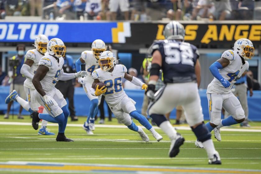 Chargers cornerback Asante Samuel Jr. runs after intercepting a pass against the Cowboys.