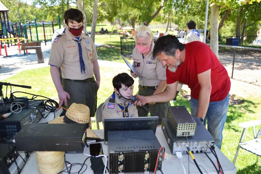 John, Jacob and Deborah McDonald and Poway Amateur Radio Society member Brian Tagg.