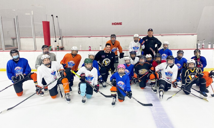 Pittsburgh Penguins star Sidney Crosby with the youth players at Poway Ice.