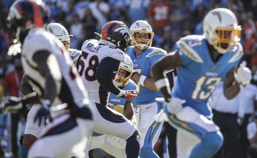 Broncos ground the Philip Rivers-led passing attack in Chargers' loss