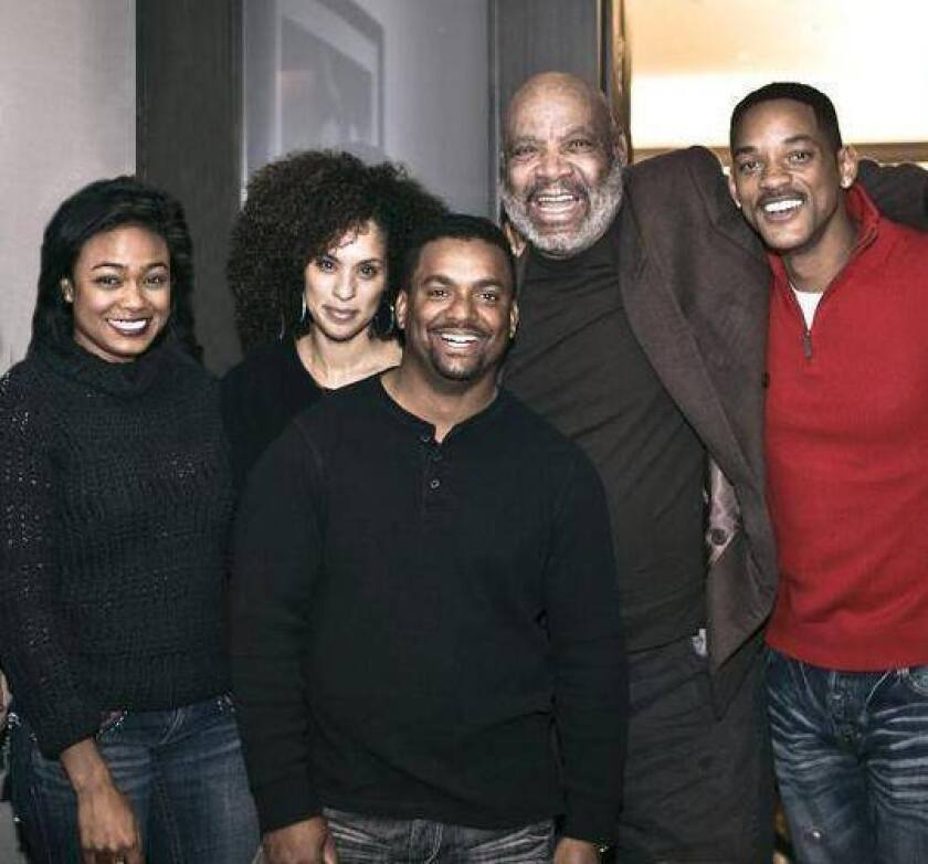 """Will Smith, right, posted a remembrance on Facebook of his late """"Fresh Prince of Bel-Air"""" costar James Avery, second from right, who played Uncle Phil on the 1990s sitcom. Also shown are costars Tatyana Ali, from left, Karyn Parsons and Alfonso Ribeiro."""