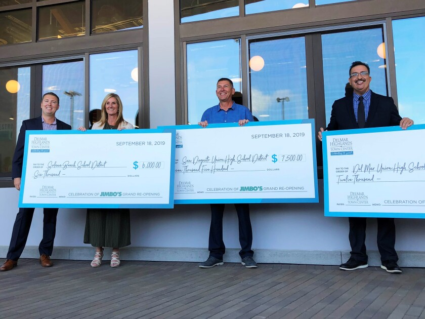 Del Mar Highlands Town Center donated $25,500 recently to local schools in support of youth education to mark the grand opening of Jimbo's at the center.