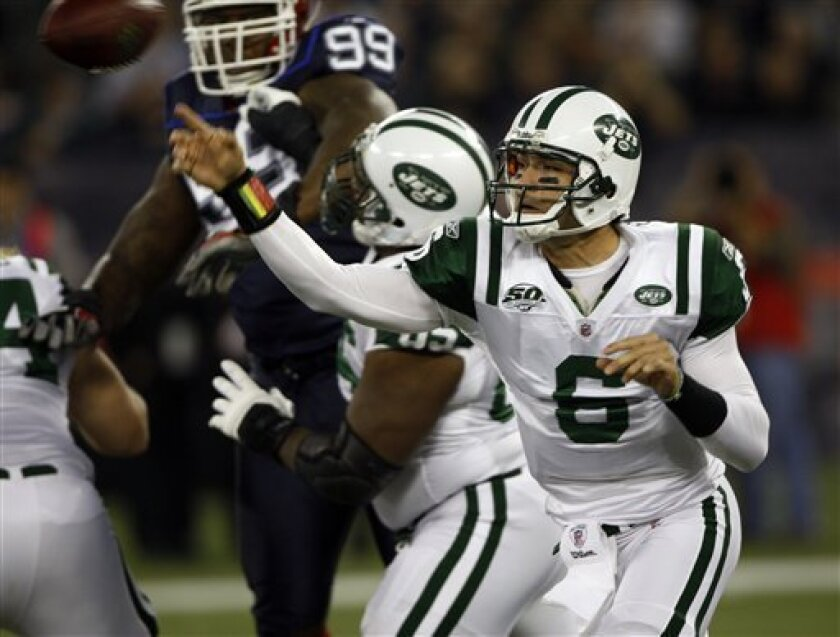 New York Jets quarterback Mark Sanchez (6) passes against the Buffalo Bills in the first quarter of an NFL football game in Toronto, on Thursday, Dec. 3, 2009. (AP Photo/Mike Groll)