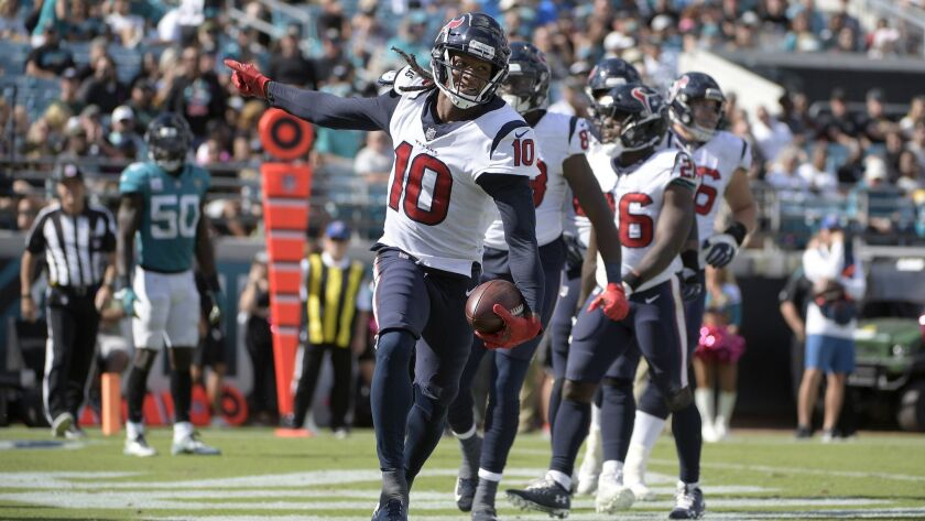 Texans wide receiver DeAndre Hopkins (10) celebrates after catching a pass in the end zone for a 10-yard touchdown during the second half against the Jacksonville Jaguars.