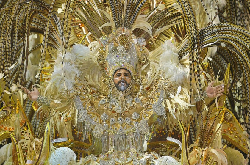 """A member of the """"Salgueiro"""" samba school performs during the first night of Rio's Carnival at the Sambadrome in Rio de Janeiro."""