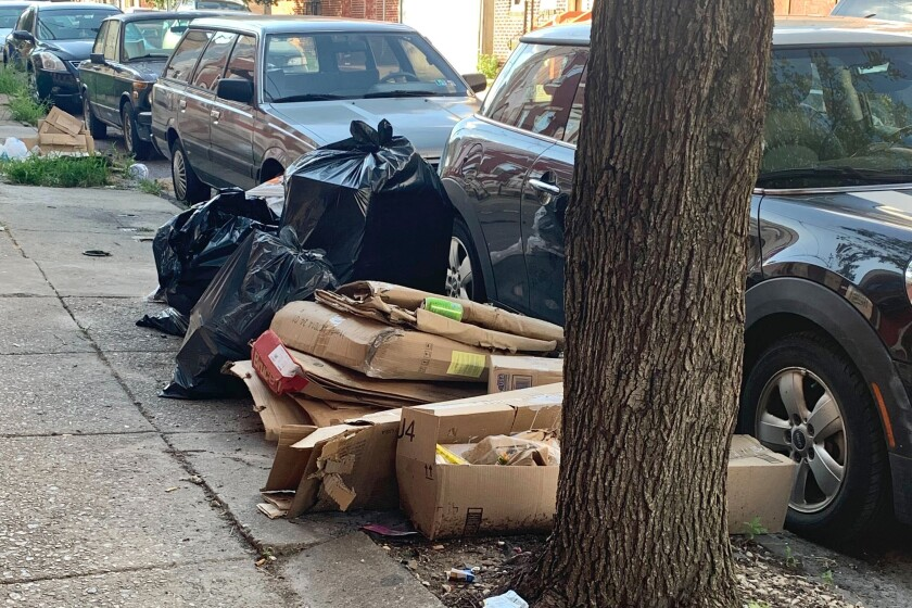 Trash is piled up on a street in the Kensington neighborhood of Philadelphia.