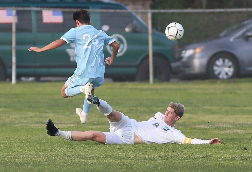 Edison's Wyatt Burris (8) disrupts a shot on goal from CdM's Taylor Demarais in Surf League soccer m