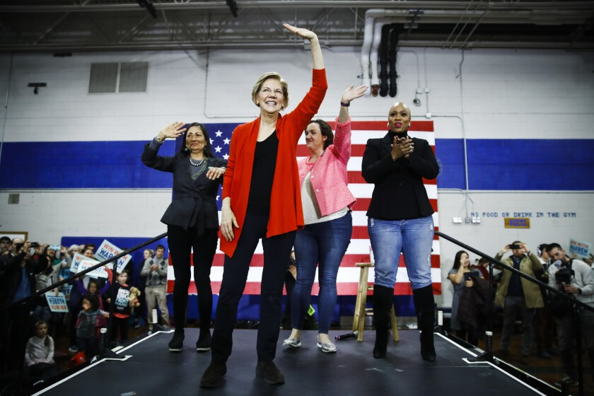 Democratic presidential candidate Sen. Elizabeth Warren, D-Mass., second left, is joined on stage by Rep. Deb Haaland, D-N.M., Rep. Katie Porter, D-Calif., and Rep. Ayanna Pressley, D-Mass., during a campaign event at Rundlett Middle School, Sunday, Feb. 9, 2020, in Concord, N.H. (AP Photo/Matt Rourke)