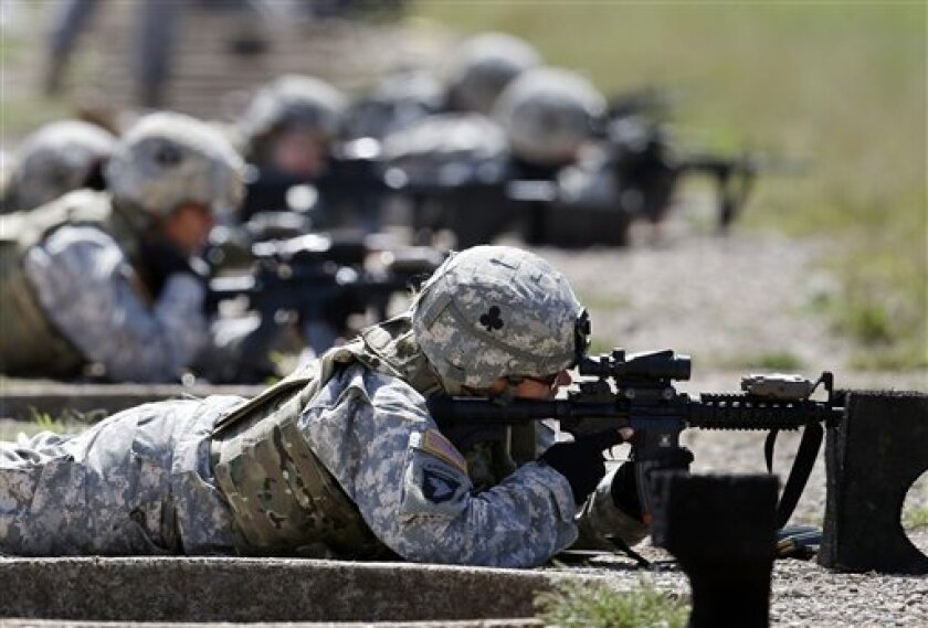 Female soldiers from 1st Brigade Combat Team, 101st Airborne Division train on a firing range while testing new body armor in Fort Campbell, Ky., in preparation for their deployment to Afghanistan. (AP Photo/Mark Humphrey, File)