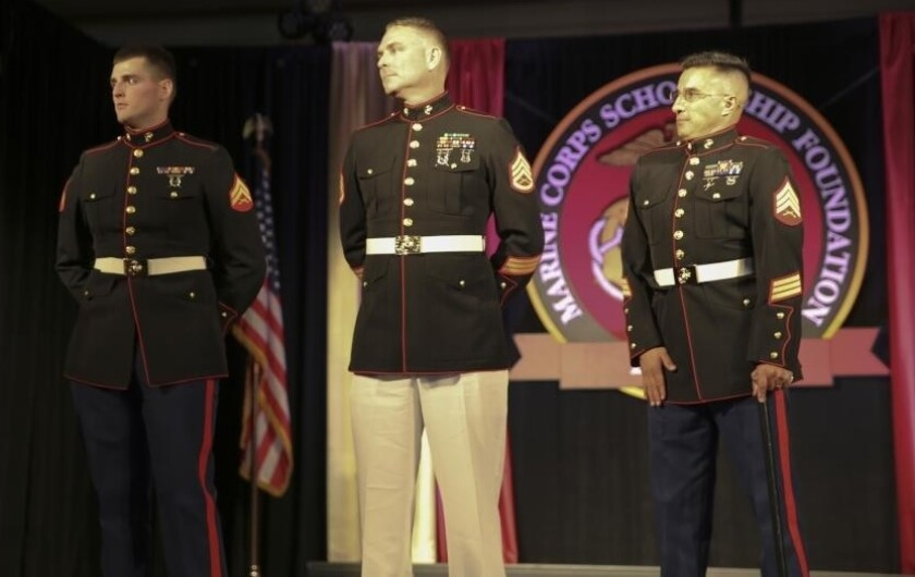Corporal Gabriel R. Gehr, Staff Sgt. Paul Swanner, and Sgt. Dominic Esquibel, stand to be recognized for their service to their country at the 32nd Annual Marine Corps Scholarship Foundation West Coast Campaign Celebratory Gala, at The Ritz-Carlton Hotel in Dana Point, Calif., Oct. 25, 2014. The three Marines were all Purple Heart Medal recipients, and were receiving scholarships for their children's future education.