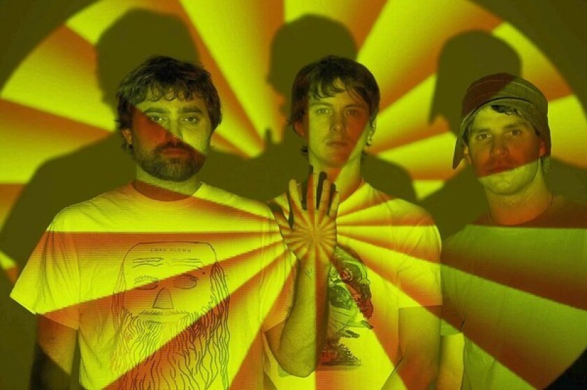 "ANIMAL COLLECTIVE: Brian Weitz, left, Noah Lennox and Dave Portner included pan flute performed by Gheorghe Zamfir in their 2009 song ""Glaze."""