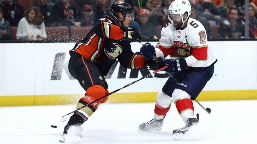 The Ducks' Hampus Lindholm (47) defends a play to the net by the Panthers' Aaron Ekblad during the second period on Nov. 19.