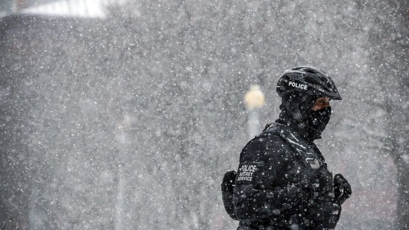 A Secret Service officer guards the White House during a Washington snowstorm Friday.
