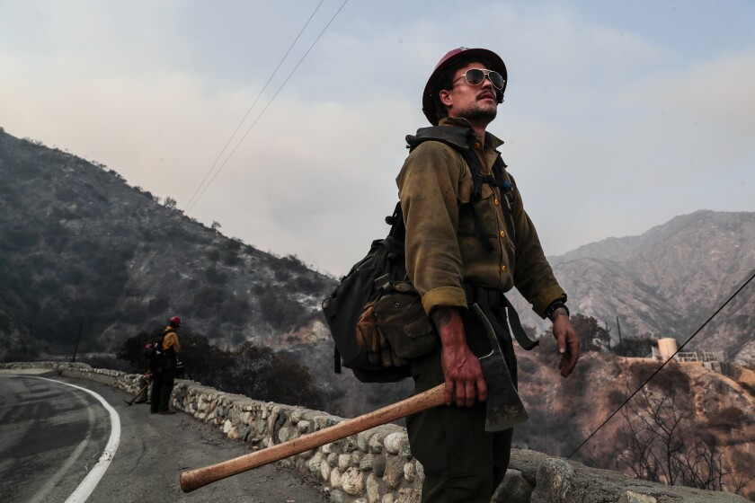 Mormon Lake Hotshot Squad leader Jessy Twin, looks over charred hillsides after clearing brush near Chantry Flat Rd.