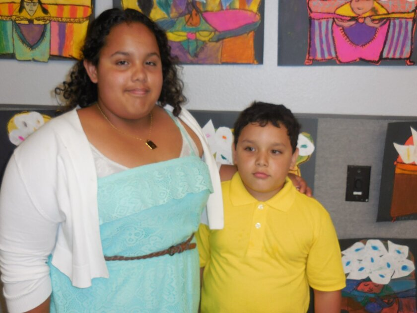 "Mariana Duran-Perez, 13, with her brother, Azael Gonzalez, 7. Mariana has participated in the Casa de Amistad program since she was in first grade. ""I'm grateful that the tutors are there,"" she says of the volunteers."