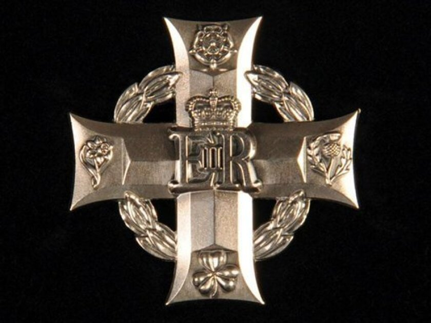 In this undated image made available by Britain's Ministry of Defence Wednesday July 1, 2009, the Elizabeth Cross, named after Britain's reigning monarch, is seen. Britain has unveiled a medal that will be offered to families of about 8,000 military personnel killed on active duty or in terrorist attacks since World War II. The nearest kin of military personnel killed in Northern Ireland, the Falklands, Iraq and Afghanistan will be among those eligible to receive the Elizabeth Cross. (AP Photo/Sgt. Andy Malthouse, Ministry of Defence)