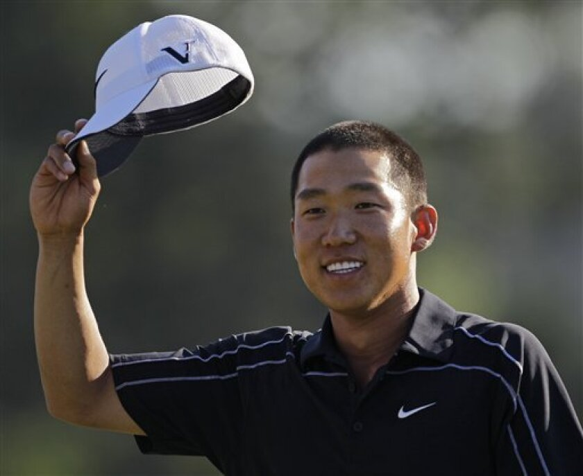Anthony Kim waves to the gallery on the 18th green after his final round of the Masters golf tournament in Augusta, Ga., Sunday, April 11, 2010. (AP Photo/Chris O'Meara)