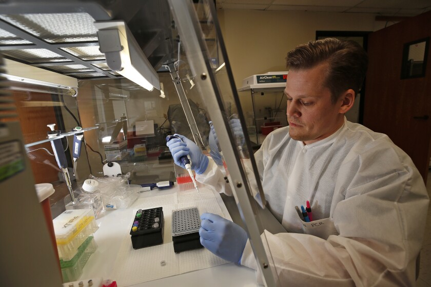Brian Bowland, senior clinical lab specialist in microbiology at UCLA Health. The University of California's five medical centers are gearing up to expand their in-house testing for COVID-19.