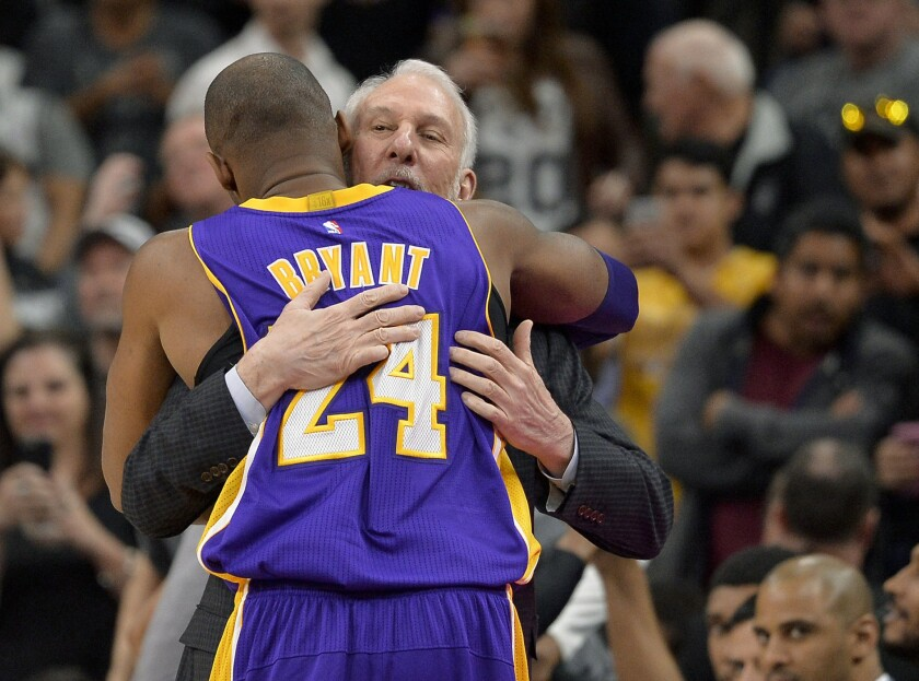 Kobe Bryant hugs San Antonio Coach Gregg Popovich before the Lakers played the Spurs on Feb. 6.