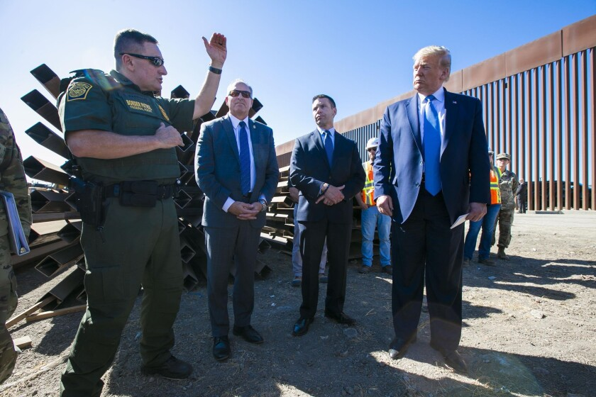 President Trump is pictured with Border Patrol officials near the Otay Mesa Port of Entry
