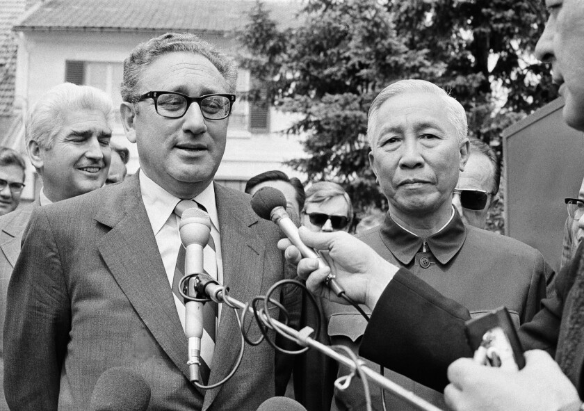 Henry A. Kissinger--then President Nixon's National Security Adviser--stands with Le Duc Tho, a member of Hanoi's Politburo, outside a suburban Paris house in June, 1973.