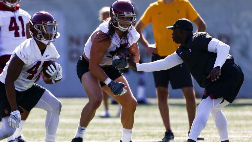 LOS ANGELES, CALIF. - AUGUST 03: USC Trojans linebacker Porter Gustin (45) center, runs through dril