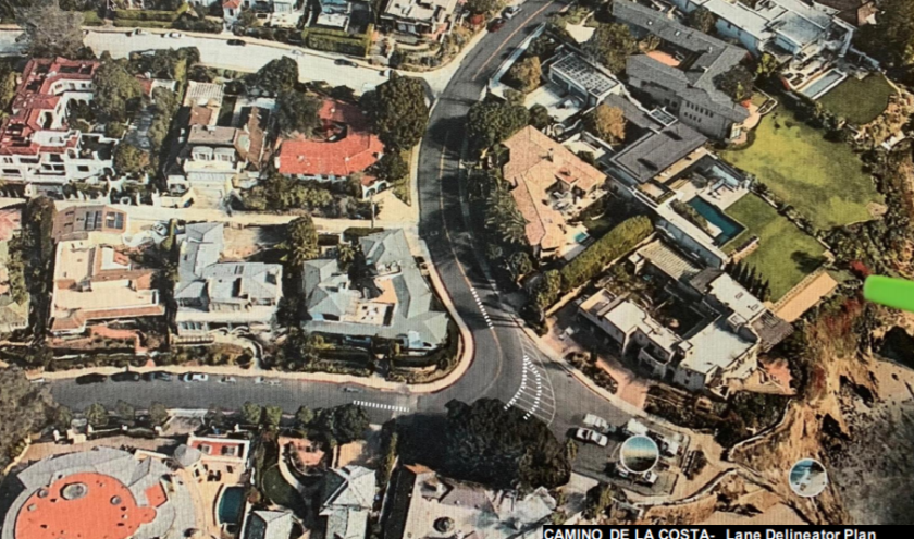 """The La Jolla traffic board voted to seek """"flexible delineators"""" at the areas on Camino de la Costa indicated by white dots."""