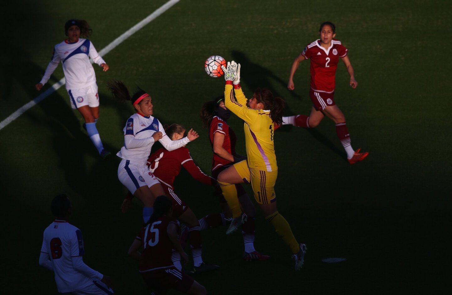 FRISCO, TX - FEBRUARY 10: Cecilia Santiago #1 of Mexico makes a save in front of Karina Socarras #9 of Puerto Rico during 2016 CONCACAF Women's Olympic Qualifying at Toyota Stadium on February 10, 2016 in Frisco, Texas. (Photo by Ronald Martinez/Getty Images) ** OUTS - ELSENT, FPG, CM - OUTS * NM, PH, VA if sourced by CT, LA or MoD **
