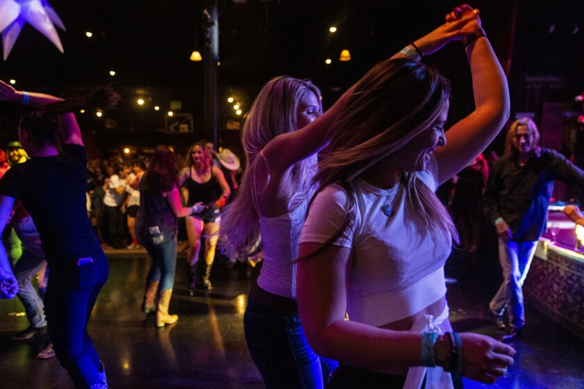 AGOURA HILLS, CALIF. - DECEMBER 20: Alexis Tait, 23, of Simi Valley dances with a friend at the Bord