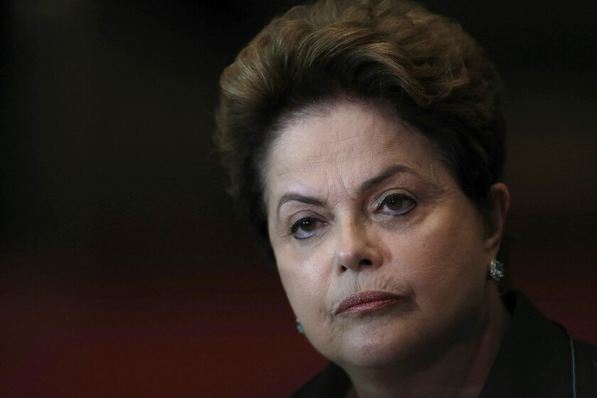FILE - In this Oct. 6, 2014 file photo, Brazil's President Dilma Rousseff listens to a question during a re-election campaign news conference at the Alvorada Palace in Brasilia, Brazil. In a letter to a Senate commission read by her top attorney on Wednesday, July 6, 2016, Rousseff told the commiss