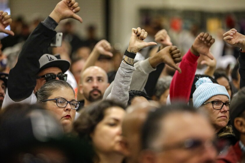 Hundreds of union members and community members from San Pedro and Wilmington show their opposition to automation during a Harbor Commission meeting.