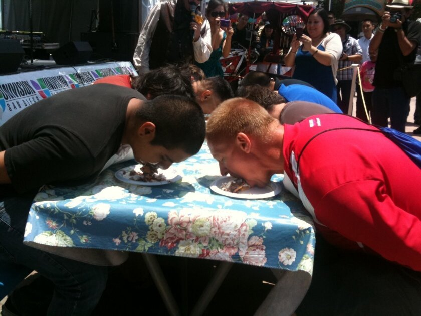 Paul Kwiatkowski, right, of Mira Mesa finished second in the fair's pie-eating contest Saturday.