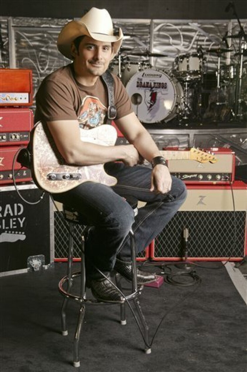 FILE - In this May 29, 2009 file photo, Brad Paisley is shown in Nashville, Tenn. (AP Photo/Ed Rode, file)