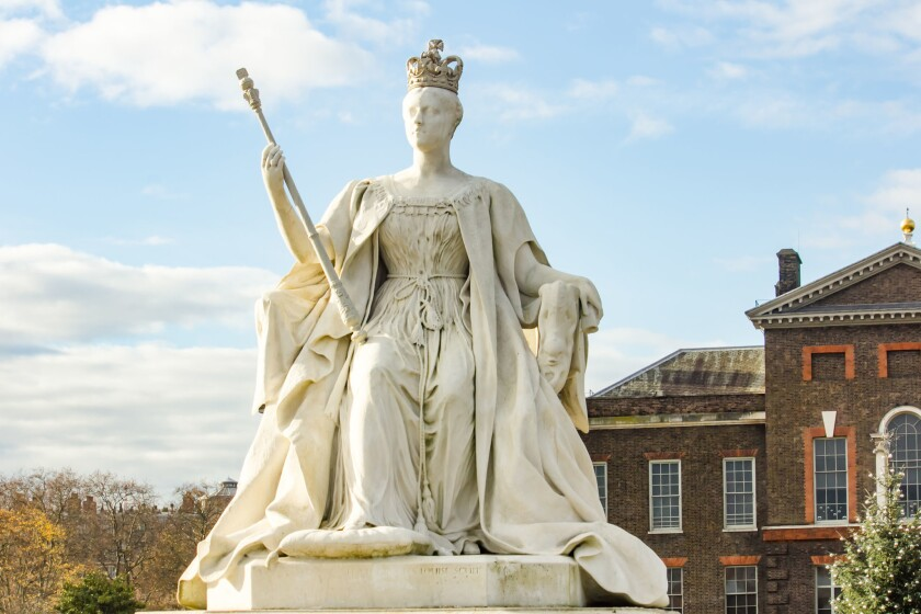 A statue of Queen Victoria, shown in her coronation robes in 1837 at the age of 18.