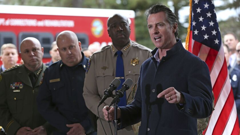 Gov. Gavin Newsom discusses emergency preparedness during a visit to the California Department Forestry and Fire Prevention CalFire Colfax station Tuesday, Jan. 8, 2019, in Colfax, Calif.