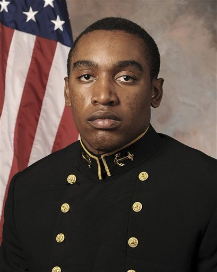 In this July, 24, 2013 photo released by the U.S. Navy Football team, Midshipmen Tre'ves Bush is shown. A hearing to determine if three Naval Academy midshipmen will face a court-martial could be nearing its end in the case of an classmante who allegedly was sexually assaulted. Navy investigators are set to testify, a week after the hearing opened, and defense attorneys hope to wrap up later in the day after commenting on the evidence. The alleged victim has testified she was drinking heavily at