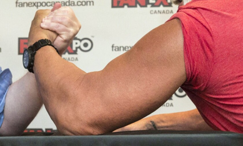 Toronto City Mayor Rob Ford, left, takes on professional wrestler Hulk Hogan in an arm-wrestling match to promote Fan Expo in Toronto on Aug. 23, 2013.