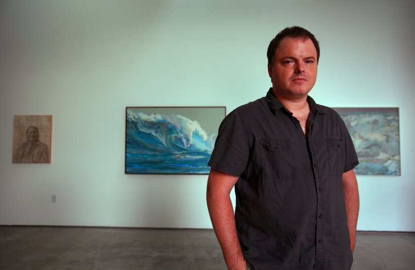 Artist in residence Matthew Cusick at the Lux Institute in Encinitas, where he creates artwork using pieces of maps. Peggy Peattie • U-T