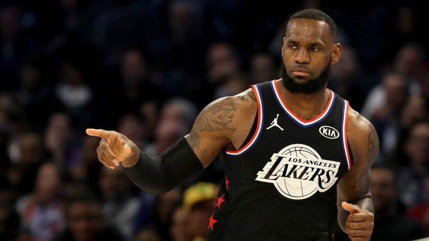 Lakers star LeBron James reacts during the first half of the NBA All-Star game in Charlotte on Sunday.