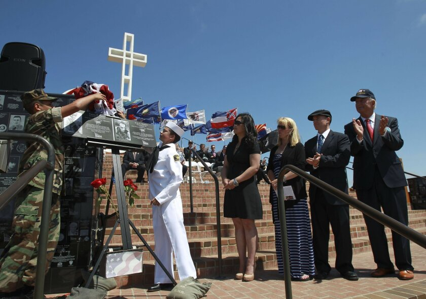 Plaques to honor Glen Doherty and Tyrone Woods were unveiled to the audience and families of the two men during the ceremony at Mt. Soledad  Veterans Memorial. LtoR Dorothy Narvaez-Woods, wife of Tyrone Woods, Kate Quigley sister of Doherty and Greg Doherty the brother of Glen Doherty and Bruce Ba
